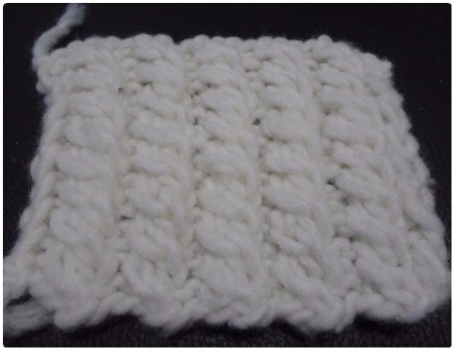 trenzas de lana tejida dos agujas pasó a paso
